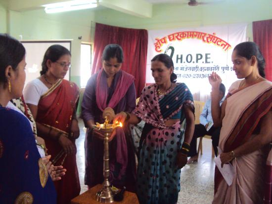Domestic workers lighting the traditional lamp to begin the celebration on the 4th May 2013